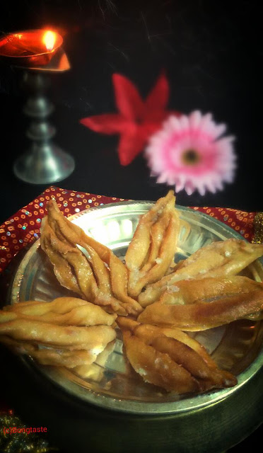 Alo Jhelo (Sugar Coated Indian Pastry)