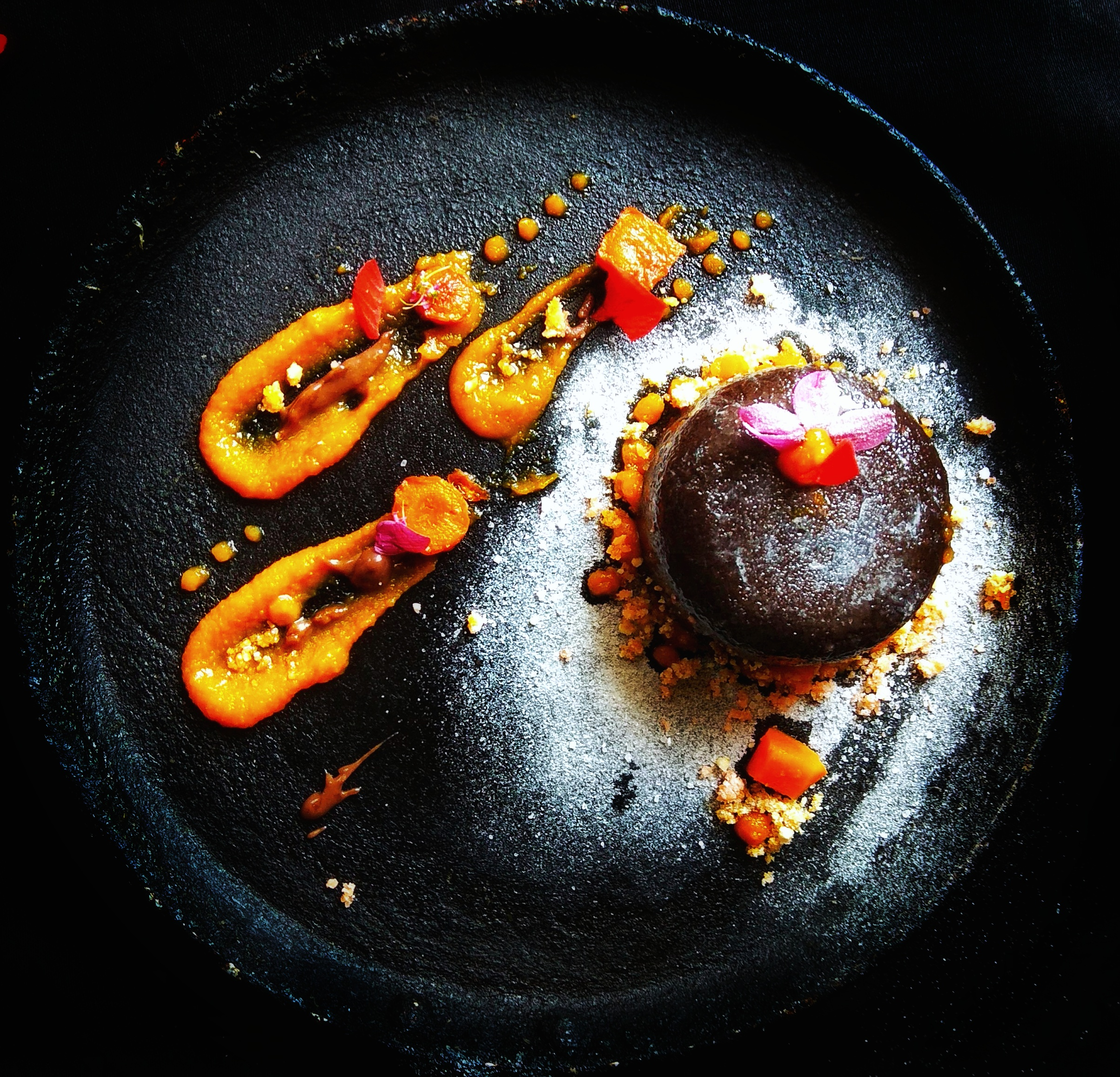 Deconstructed gajar halva representing carrot lava cake with carrot caramel sauce: