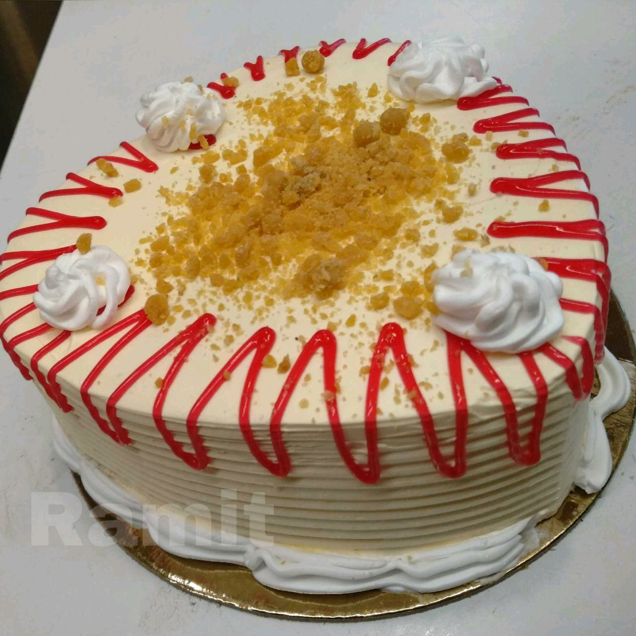 Caramel Crunch Cake Topped With Strawberry Jelly