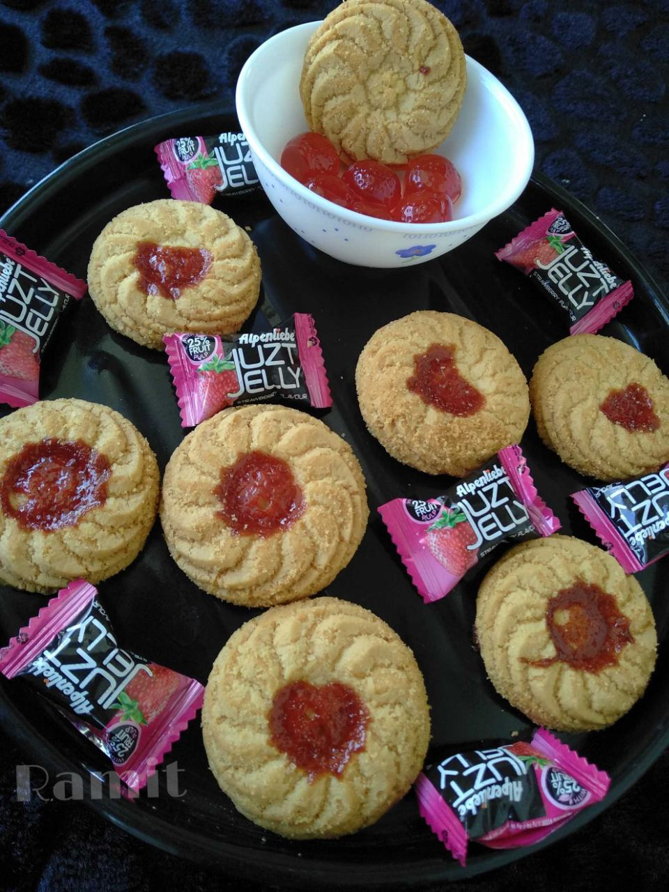 JuztJellyCookies/Fingerprint Cookies.......- Cookies made with innovation, earlier i used to make these cookies using jam of any brand & of any flavour, today i did innovation using Juzt Jelly, it really turned out awesome, must try out. (Note- I used strawberry Juzt Jelly but you can use any flavour of Alpenliebe Juzt Jelly, to give flavour to your cookies)