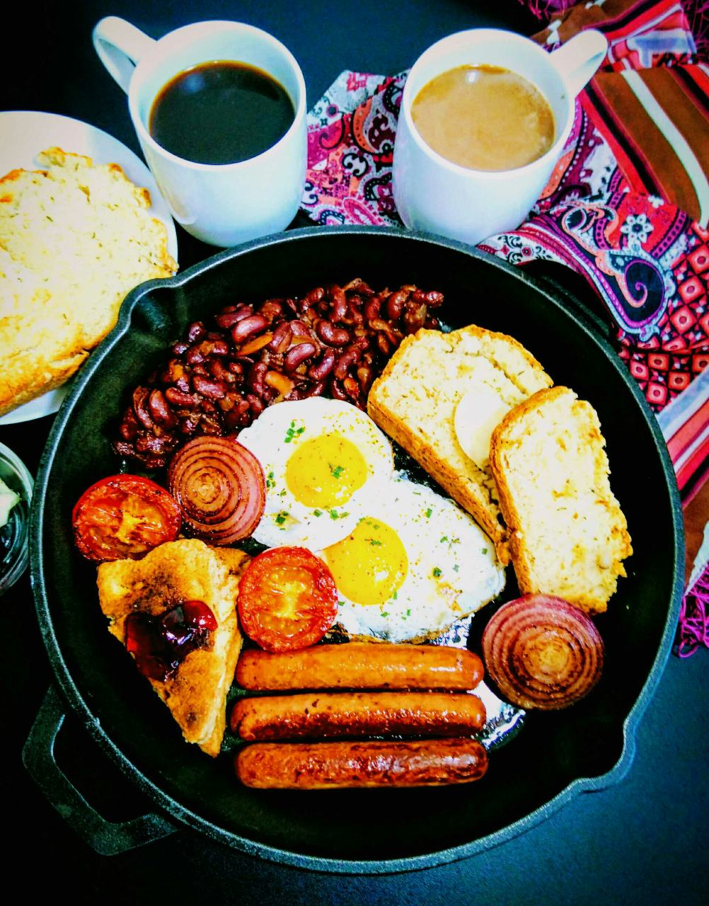 Full English Breakfast With Eggs, Sausages, Beans, Soda Bread, Scones, And Grilled Tomatoes